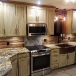 kitchen with beige counters and cabinets