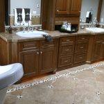 brown bathroom counter and cabinets