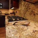 beige kitchen counters and backsplash