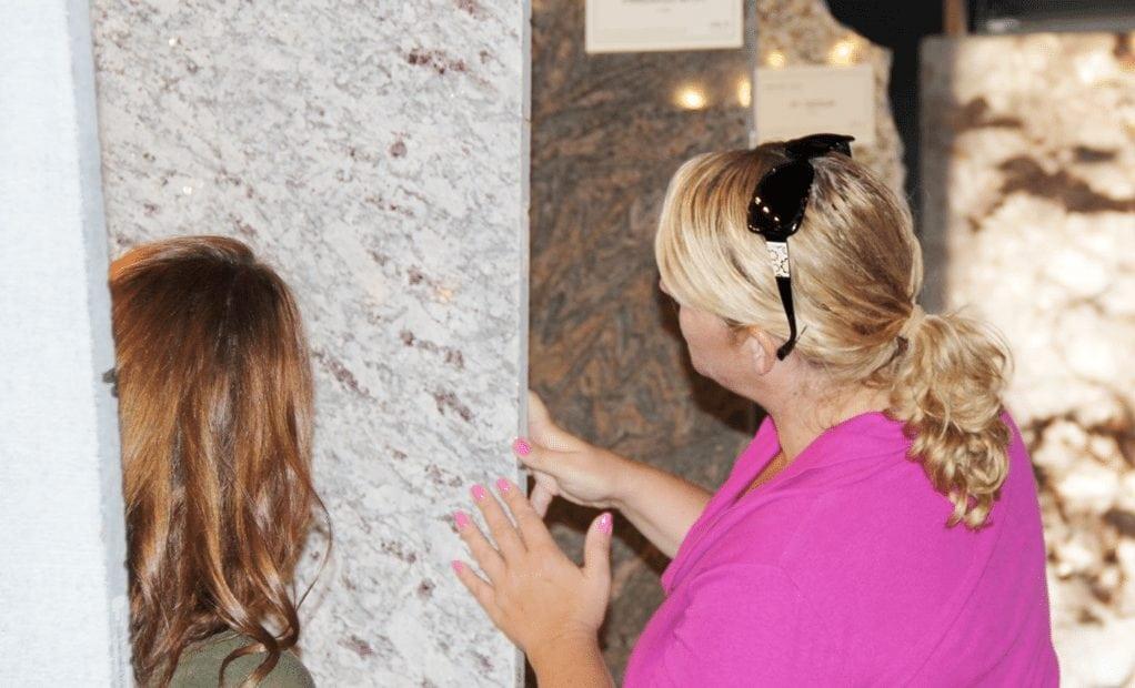 women looking at granite