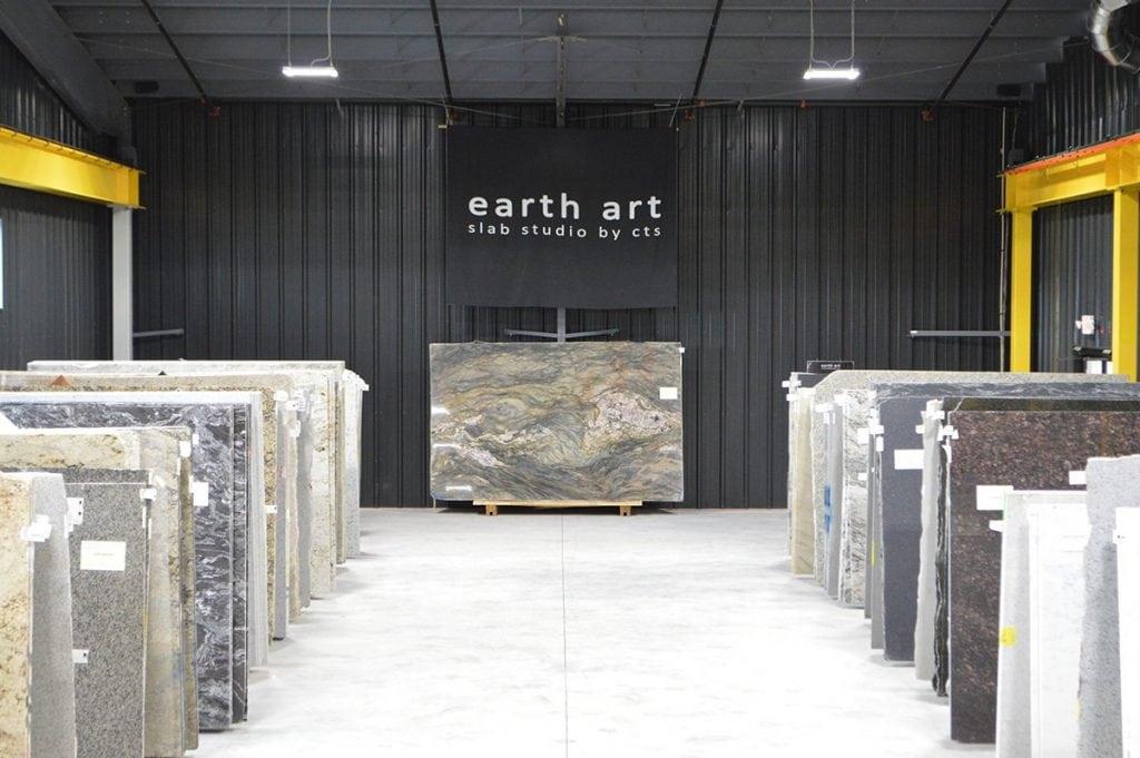 "slabs of granite under banner for ""earth art slab studio by cts"""