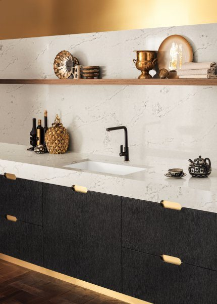 white marbled counter and black cabinets