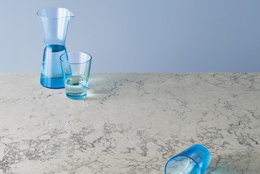 invory counter with blue shot glasses