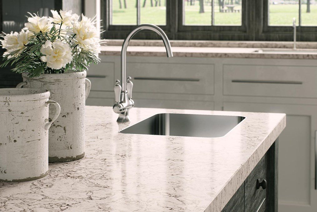 ivory and black counter with sink and white flowers